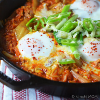Eggs in tuna kimchi jigae for #BrunchWeek.